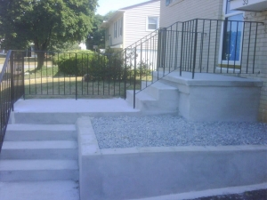 Concrete stairway and porch with retaining wall